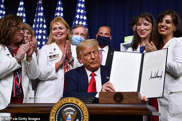 Trump cast his directives as far-reaching, but they mostly update earlier administration ideas that have not yet gone into effect;Trump signs an executive order on lowering drug prices at the White House, in Washington, DC on July 24