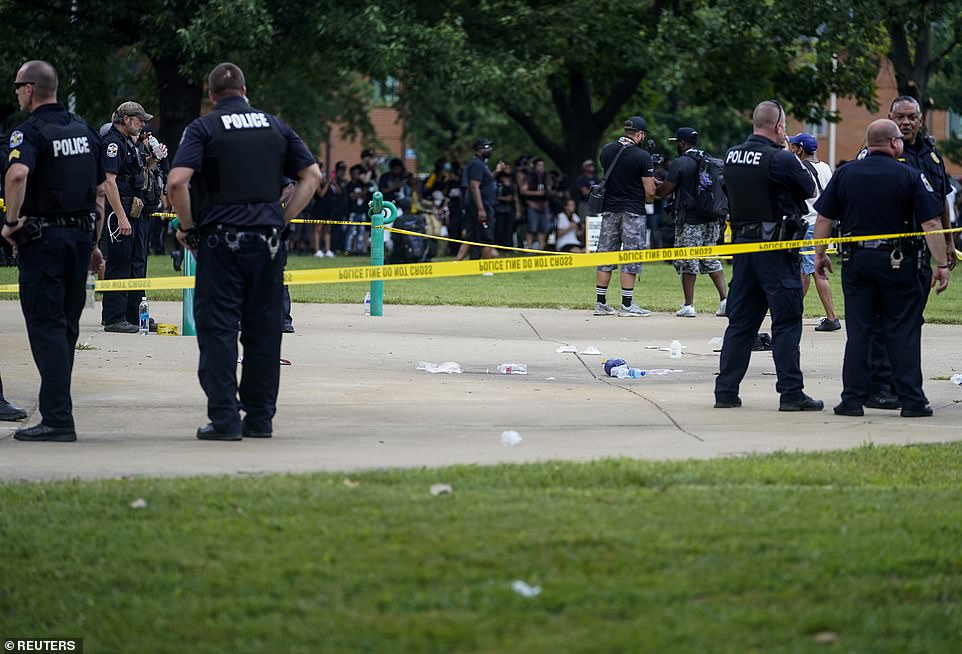 Police ring the area with yellow tape as they investigate the shooting in Louisville, Kentucky, on Saturday
