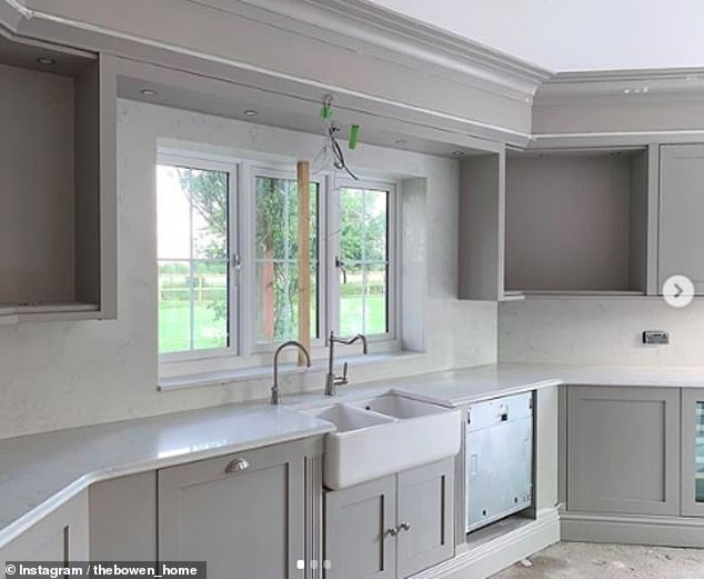 All in the details: The couple's kitchen boasts stylish granite work tops and a stunning view of the garden