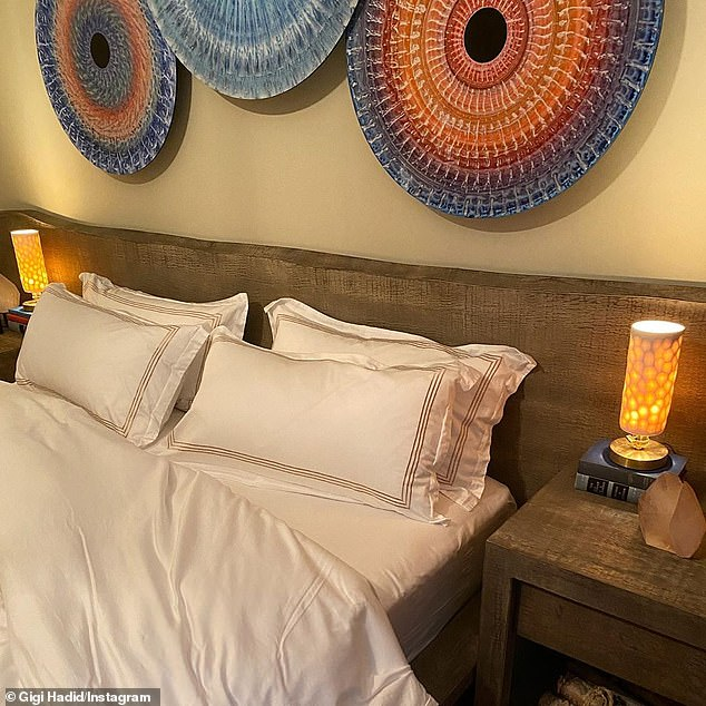 Relaxing: Gigi's bed was surrounded by a rescued wood headboard and matching nightstands featuring a lava lamp–like fixture by Sean Forest Roberts