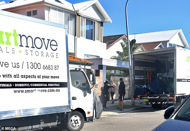 Moving: A truck was parked on the street in front of her home, with much of her furniture littering the footpath and nature strip