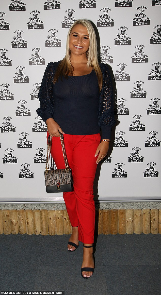 Striking:Saffron Lempriere cut a stylish figure in bright red trousers and a black top
