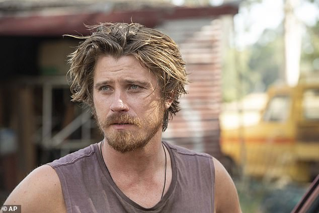 Father-in-waiting:The Scream 4 star is awaiting her baby with boyfriend Garrett Hedlund, the hunky actor of Tron and Country Strong fame; seen here in this month's Dirt Music