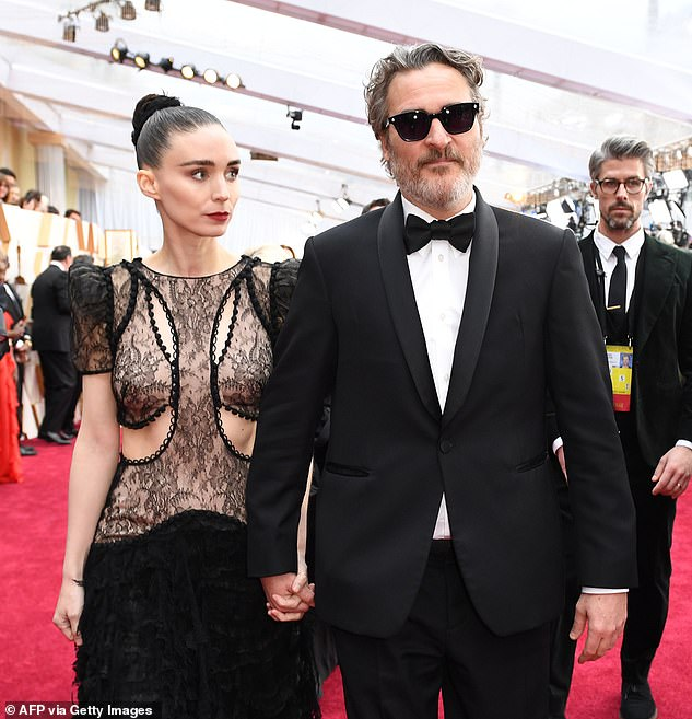 Family expansion: Rooney Mara is reportedly pregnant with her first child with fiance Joaquin Phoenix; they are pictured at the 92nd Academy Awards in Los Angeles in February 2020