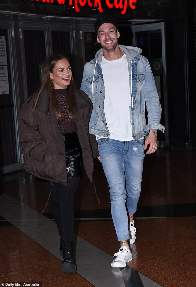 EXCLUSIVE: Big Brother couple Chad Hurst (right) and Sophie Budack (left) were spotted enjoying a low-key date night at Hard Rock Cafe in Sydney on Friday night