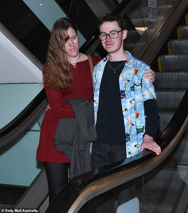 His lady: Ian, 25, wore one of his signature graphic print shirts as he was joined by his environmental scientist girlfriend Kerryn Davis
