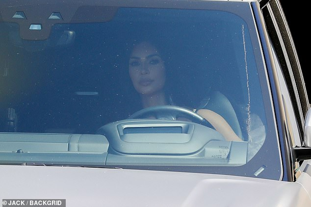Hard times: The reality TV icon, 39, put on a brave face as she took her car for a spin in Los Angeles on Saturday afternoon