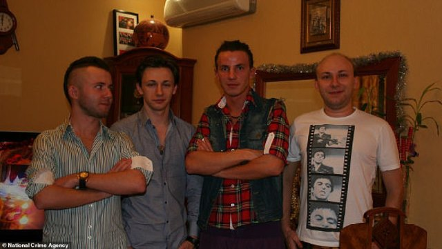 Maksim Yakubets is pictured second from left along with other Evil Corp members who allegedly 'provide material assistance' including, from left, Kirill Slobodskoy, Dimitriy Slobodskoy, in red shirt and Artem Yakubets, far right
