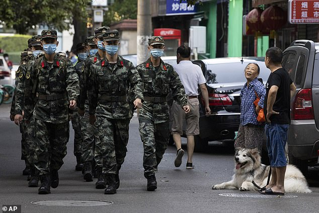 Over the weekend, removal trucks entered the site and cleaners were seen carting large black rubbish bags from the consulate, and on Saturday AFP reporters saw workers removing the US insignia. Police are seen marching near the United States Consulate in Chengdu on Monday