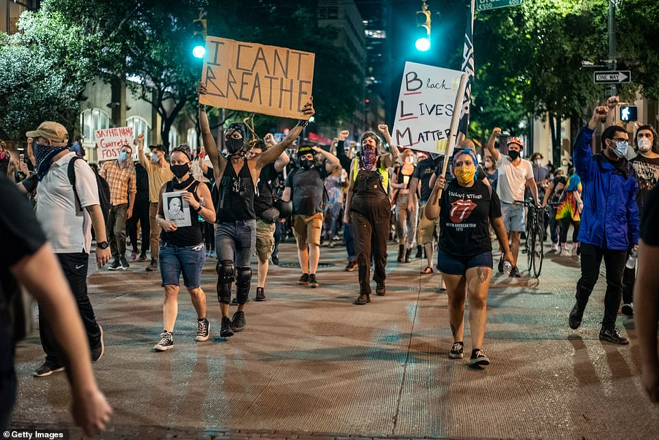 Demonstrators march on the Texas State Capital in Austin as part of Black Lives Matter demonstrations which have now been ongoing for 60 days