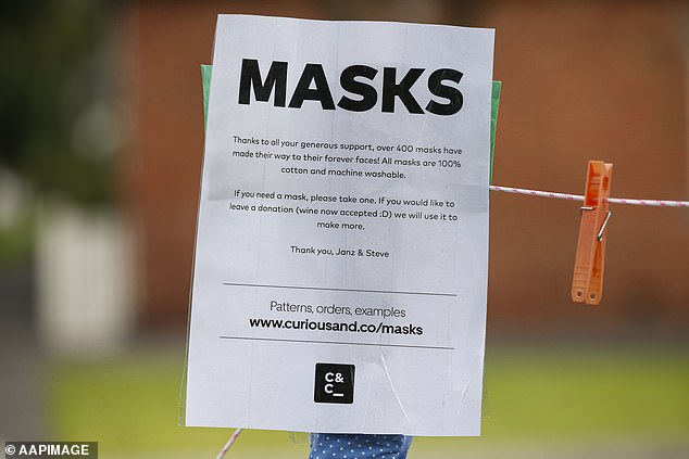 Masks are now compulsory in Melbourne and Mitchell Shire. Pictured: a sign in South Melbourne on Monday advertising home-made masks in return for donations or wine