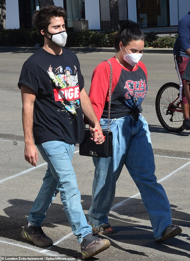 Bonded: The couple held hands as they embarked forward on their outing
