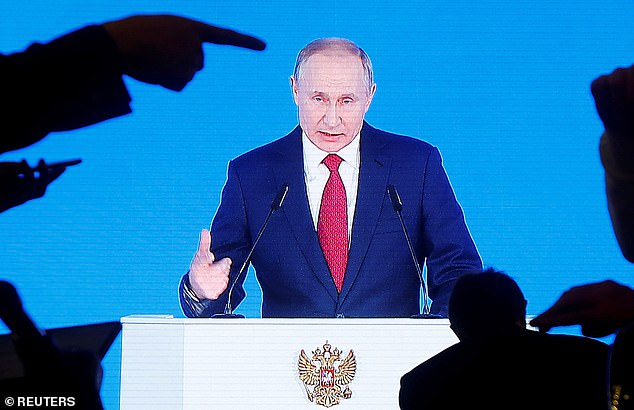 Russian President Vladimir Putin is seen on screen as he delivers his annual state of the nation address to the Federal Assembly in Moscow, January 15, 2020