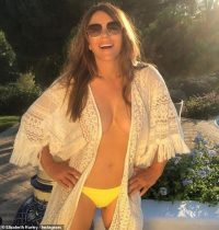 Elizabeth Hurley, 55, sizzles in open kaftan and yellow bikini bottoms as she flaunts ample assets