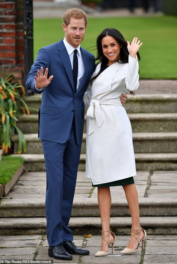 Meghan Markle and Prince Harry pose for a photo on November 27, 2017 at Sunken Gardens in Kensington Palace, west London, after announcing their engagement.