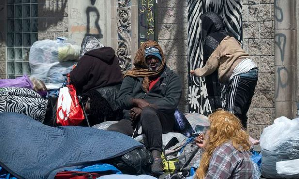 Four men admit to paying LA homeless people in voter fraud scheme