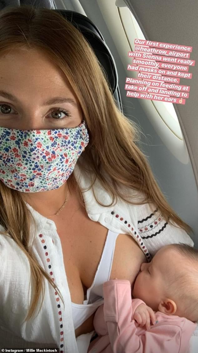 At peace: On Tuesday, Millie uploaded a sweet snap of herself breastfeeding her daughter Sienna during her baby's first flight