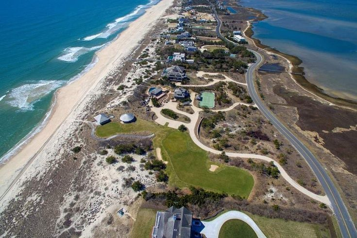 'Billionaire's Lane' - officially called Meadow Lane (pictured) - overlooks Shinnecock Bay to the north and the Atlantic Ocean to the south, seen on the left. The property spans the finger of land and sits across both