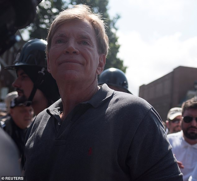 On Friday, former KKK Grand Wizard David Duke was permanently banned from Twitter for violating rules on hate speech. Pictured: Duke participates in a white supremacist rally in Charlottesville, Virginia, August 2017