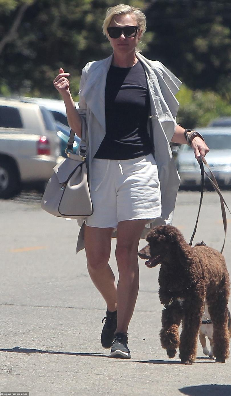 On Friday, Ellen was nowhere to be seen as her wife Portia de Rossi stepped out in Los Angeles amid the drama