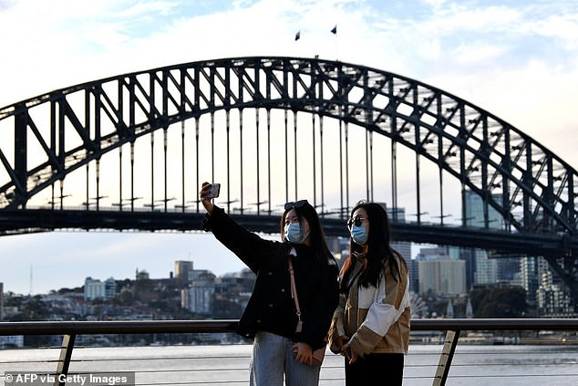 Professor Clive Hamilton said it was 'only a matter of time' before social media app TikTok was banned in Australia (pictured, women taking a selfie in Sydney on July 22)