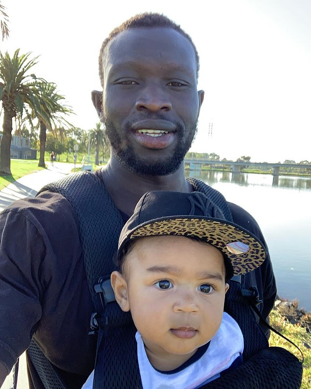 Daw pictured with his son Hendrix who turns one at the end of August