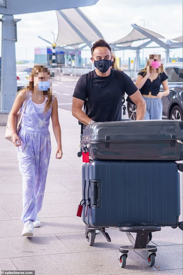 Family time: Ant appeared excited for their family holiday as he chatted away to Anne-Marie's youngest daughter
