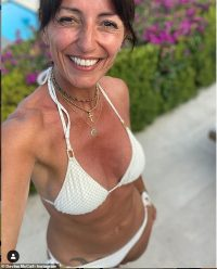 Davina McCall, 52, flaunts her taut abs in a sizzling white bikini as she enjoys holiday in France