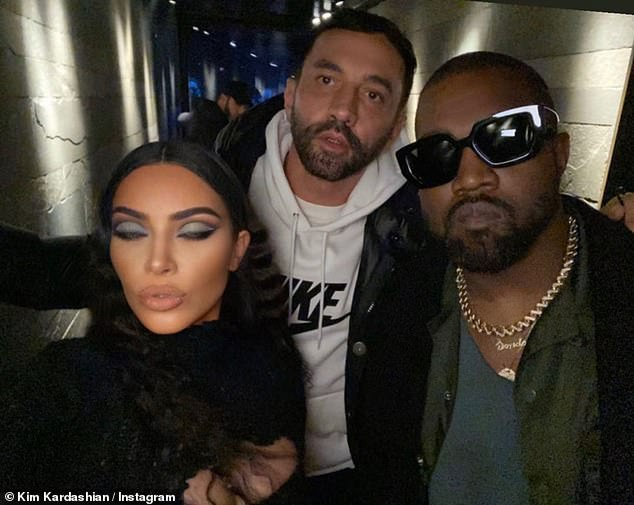 Happy day: Kim Kardashian posted a string of Insta Stories pictures this Saturday wishing a happy 46th birthday to Riccardo Tisci; they are pictured with her husband Kanye West