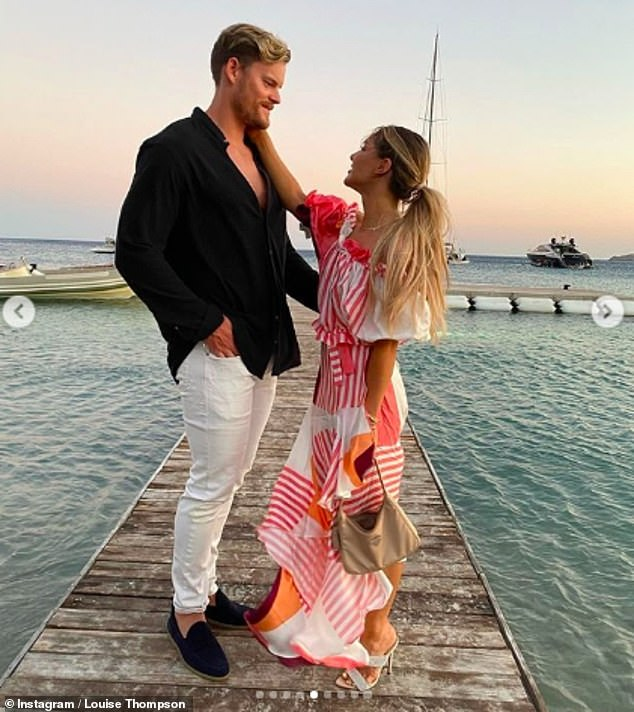 Love: Louise doted on her partner as they posed for a few sun-soaked snaps