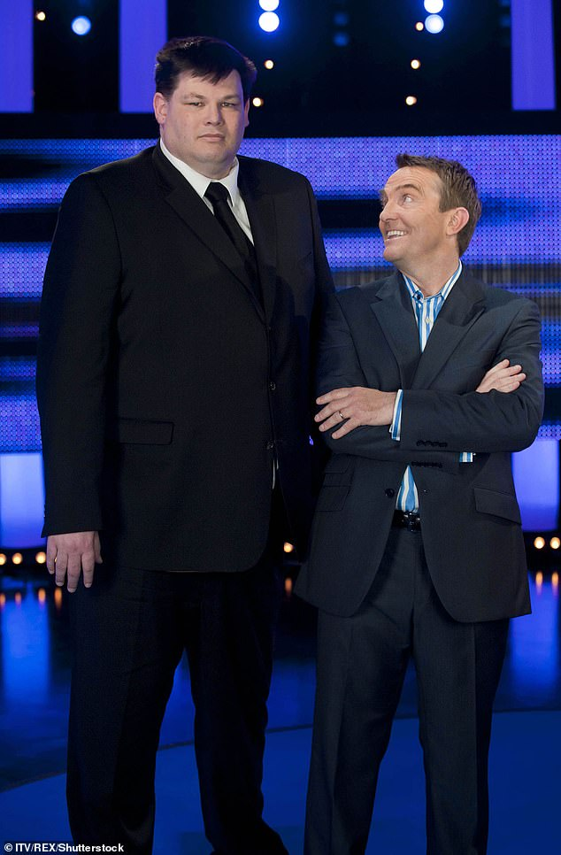 Co-stars: Mark has entertained audiences on The Chase since 2009 (he is pictured with the show's host Bradley Walsh in 2014)