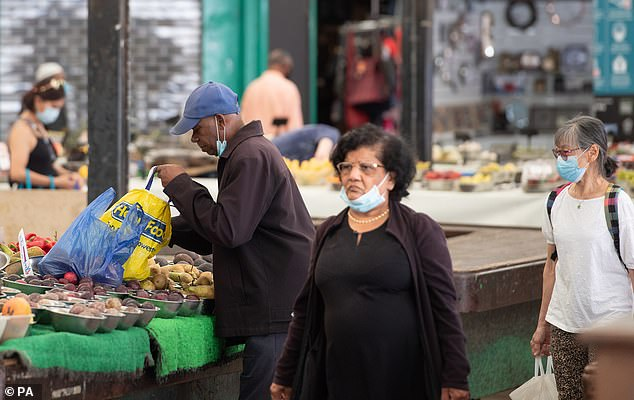 People are pictured shopping at Leicester market. It is a fact, not a 'conspiracy theory', that the power of the state is now being used to keep us in a condition of perpetual alarm