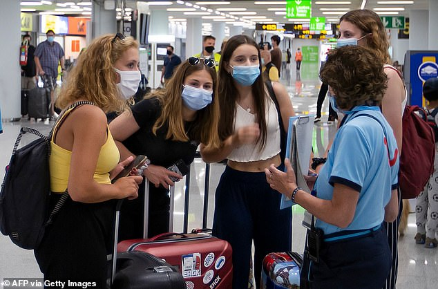 No escape: A holiday rep warns British tourists arriving in Majorca last week about the new quarantine rules. According to the Coronavirus Worldometer, the daily Covid deaths in Spain for the past few weeks have rarely risen above five a day, and have often been fewer than that