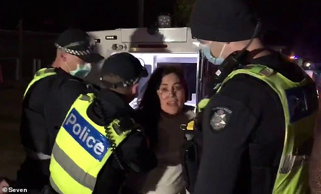 A woman was dramatically arrested at a police roadblock outside a gym where a group of coronavirus conspiracy theorists have been meeting