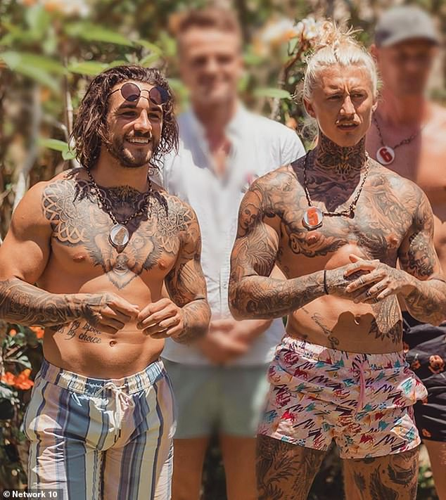 Ouch!Bachelor In Paradise star Alex Mckay (left) reveals he got inked with a tattoo of Bachelorette Angie Kent BLEEDING following his rejection by the blonde on the franchise in 2019. Pictured with tattooed co-star Ciarran Stottt