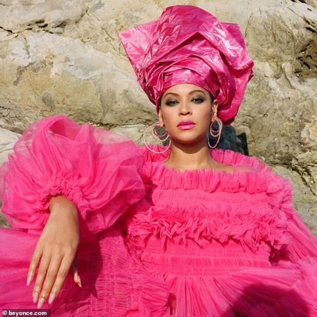 Pretty in Pink: Beyoncé also adorned a fuchsia chiffon dress by Molly Goddard, which featured a chunky layered skirt and ruffle details