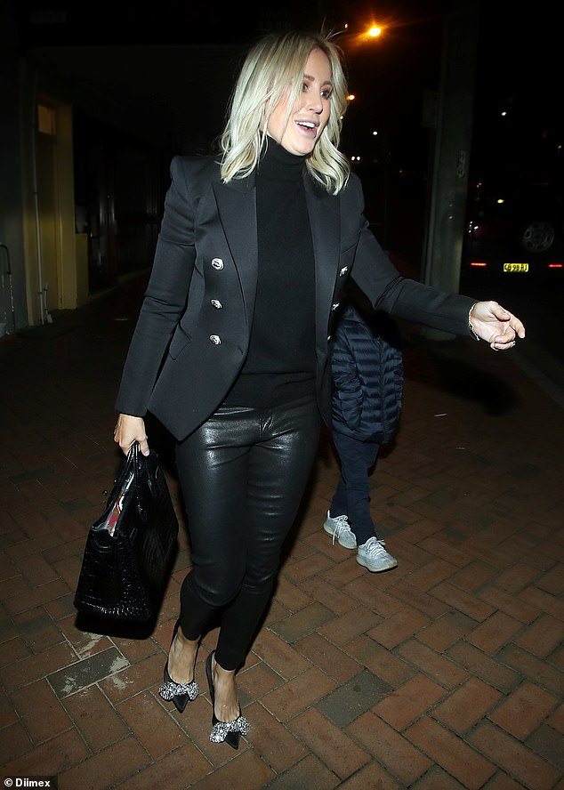 Roxy Jacenko arrives at husband Oliver Curtis' 35th birthday dinner with son Hunter in Sydney