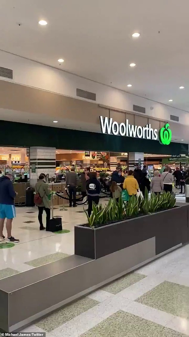 A Woolworths in Melbourne lines up outside his supermarket as panic shopping hits the city