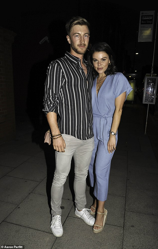 PDA:Faye Brookes looked smitten with her personal trainer boyfriend Joe Davies as they stepped out in Manchester on Saturday