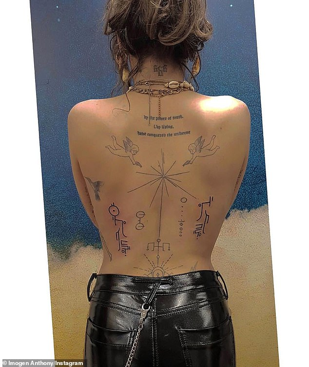 She told a fan of the tattoo: 'It's just a representation of the Universe, Golden Plaque from the Voyager, nature and animals, mother nature being destroyed, religion, aliens, all that kinda weird stuff. Also about religion shooting down any ideas of other life in the Universe. I'm weird'