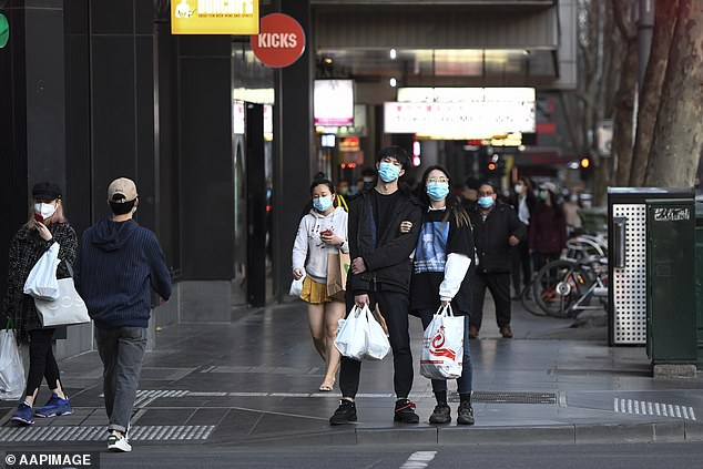 People are seen out hours before a citywide curfew is introduced in Melbourne, Sunday, August 2