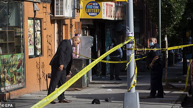 Police investigate a shooting in the Bedford-Stuyvesant neighborhood of Brooklyn on July 16