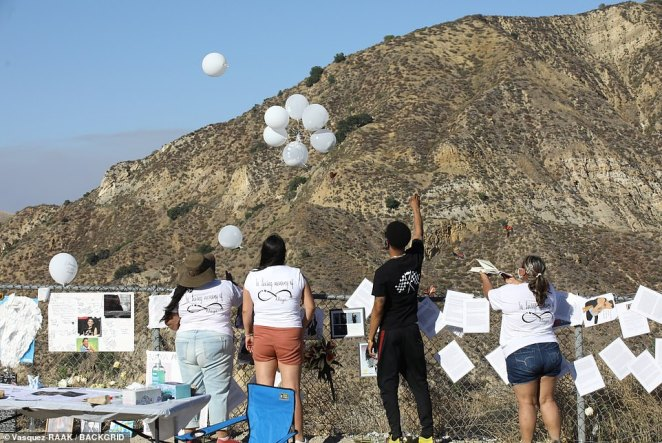 Fans are seen releasing balloons over the lake where Rivera tragically lost her life last month