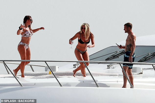 Who knew they were friends? Caprice helped Rebekah Vardy took her mind off her legal case with Coleen Rooney as they enjoyed a yacht trip with their families in Formentera on Saturday