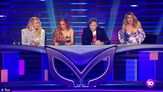 'We have a Zoom audience at home of super-fans': The show is no-longer filmed in front of a live studio audience, but rather a panel of online spectators. Pictured: The Masked Singer 2019 judges Jackie 'O' Henderson, Lindsay Lohan, David Hughes, Dannii Minogue