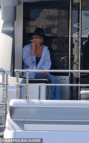 Smokescreen: The streetwear queen quickly darted to the side of the boat for a ciggie with her wine