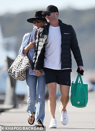 Romance: Pip rested her head on Michael's shoulder as they looked every inch the loved-up couple during the outing