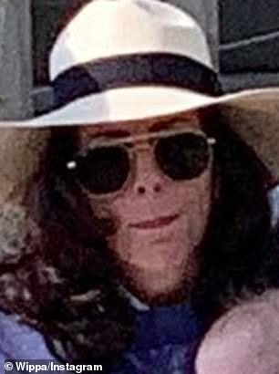 Spooky! The 40-year-old radio host admitted to being in the 'doghouse' after he'd taken this photo of Lisa looking eerily like late pop superstar Michael Jackson while they were enjoying a day out in Sydney's Rose Bay