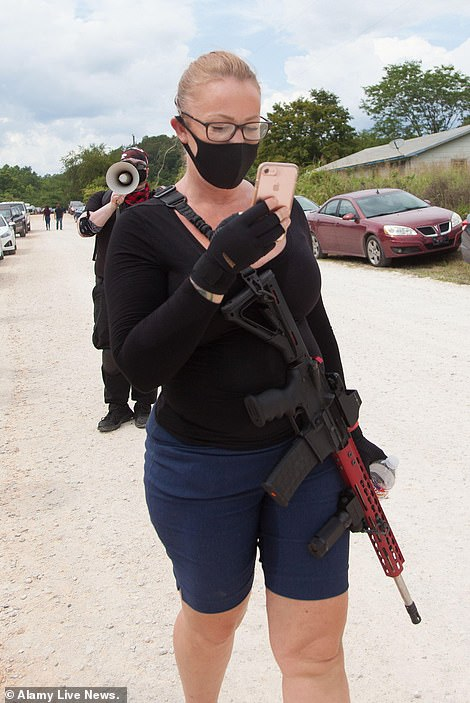 An armed protester is seen in Zinc