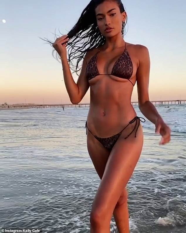 Barely there: The 25-year-old, who is based in California, left little to the imagination in a tiny animal print bikini with g-string bottoms